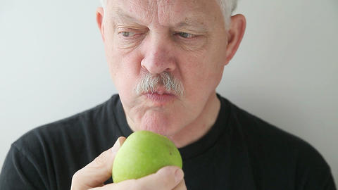 man eats green apple front view Stock Video Footage