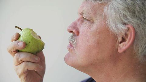 man eats pear Footage