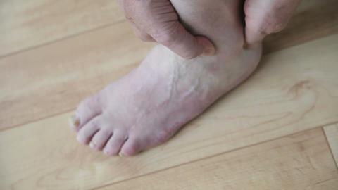 man massaging his foot Stock Video Footage