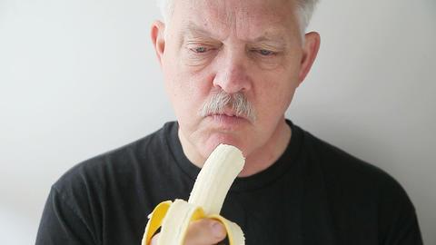 Man Eats Banana stock footage