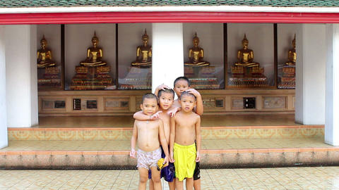 Children and Golden Buddha Statues Stock Video Footage