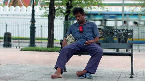 homeless sleeps funnily Stock Video Footage