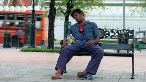 homeless sleeps funnily Stock Video Footage