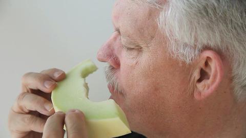 man eats slice of melon Footage