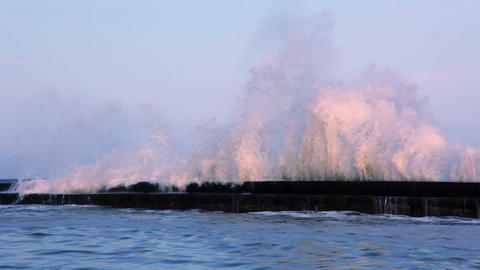 Surf Wave on the Breakwater at Sunset. Slow Motion Footage