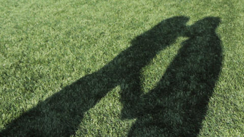 Couple Kissing Shadow On The Football Field Footage