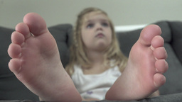 DOF view of Child Mezmerized by a Television Show (1 of 3) Footage