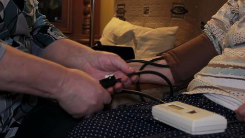 Domestic Blood Pressure Measurement - Pumping stock footage