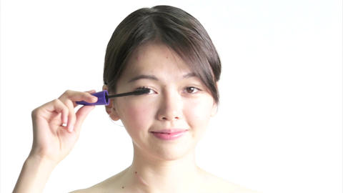Chinese Woman Applying Mascara Live影片