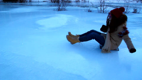 Funny Girl In Orange Glasses Riding On Ice stock footage
