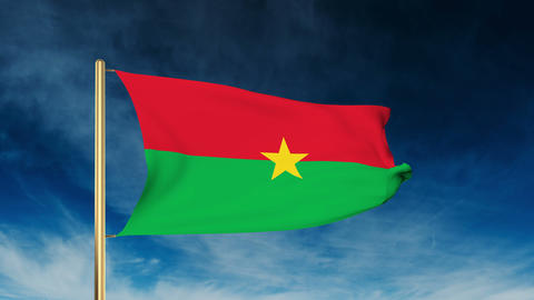 Burkina Faso flag slider style. Waving in the wind with cloud background animati Animation