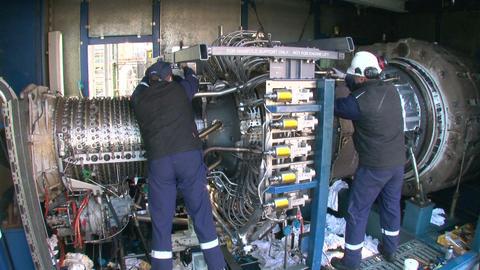 Engineers Repairing a Gas Turbine Footage