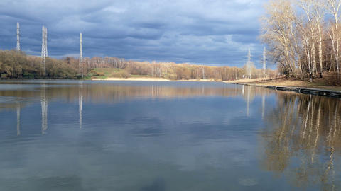 Lake In The City With Reflection Of Clouds In The Spring 4k , UHD stock footage