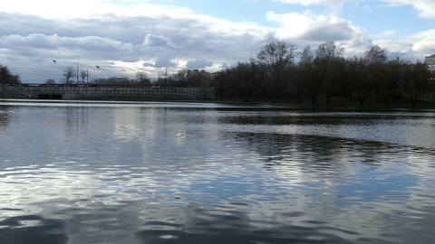 Lake in the city with reflection of clouds in the spring Footage