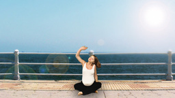 Pregnant woman exercising at seaside Stock Video Footage