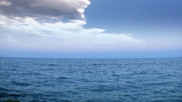 Open ocean and time-lapse stormy clouds Stock Video Footage