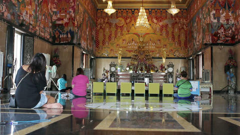 buddhist people pray in temple Stock Video Footage