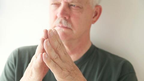 Older Man Taps Fingers Together stock footage