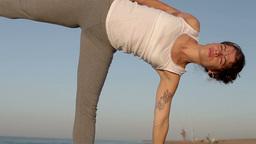yoga beach sunrise peaceful energy healthy lifestyle Footage