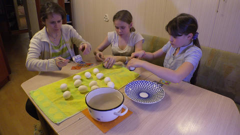Mother and daughter prepare and decorate Easter eggs. 4K Footage