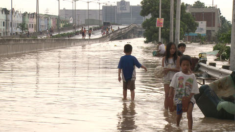 Street Kids Walk Through Filthy Flood Waters In Manila Philippines Footage