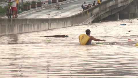 Man Wades Through Dangerous Flood Waters In Manila Philippines Footage
