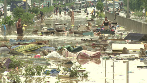 People Wade In Filthy Flood Waters In Manila Philippines Footage