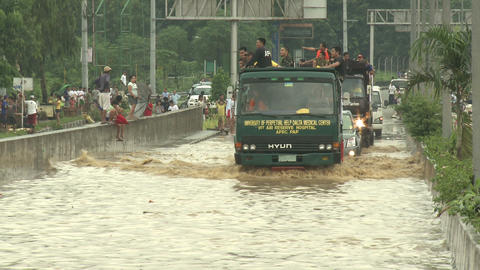 Aid Trucks Drive Through Flooded Road In Manila Philippines Footage