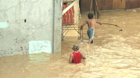 Men Wade Through Dangerous Flood Waters In Manila Philippines Footage