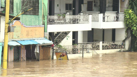 Flood Waters Flow Through Residential Area Of Manila Philippines stock footage