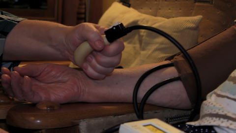 Domestic Blood Pressure Measurement - Pumping 2 stock footage