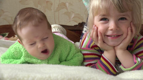 Little Girl and Newborn Baby, Two Sisters, Watching TV. 4K UltraHD, UHD Footage