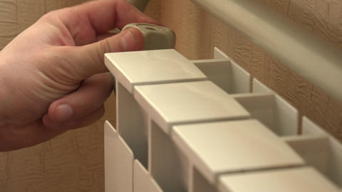 Optimal Setting Of The Thermostat Valve. Radiator Adjustment To Save Energy. Rad stock footage