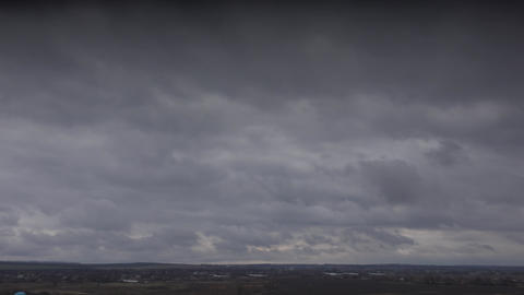 Massive Clouds Over a Willage. 4K UltraHD, UHD Footage