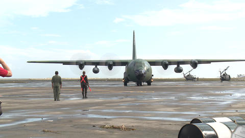 Hercules C130 Typhoon Haiyan Relief Tacloban Airport stock footage