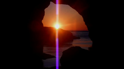 Sunset through a cave - Sea Caves, time lapse Footage