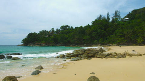 Beautiful little beach with golden sand and rocks. Thailand. Phuket Footage