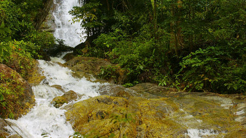 Whitewater Cascading over a Natural Waterfall in Thailand. with Sound Footage