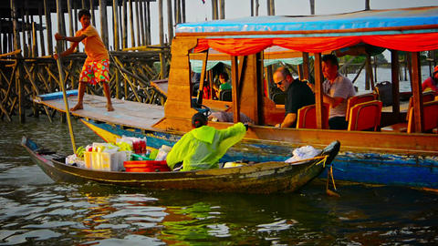 TONLE SAP LAKE. CAMBODIA - CIRCA DEC 2013: Local tourists snap photographs from Footage