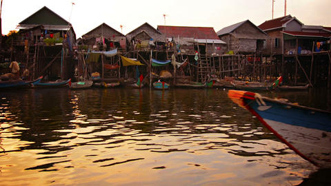 TONLE SAP LAKE. CAMBODIA - CIRCA DEC 2013: Entire Cambodian village built on pil Footage