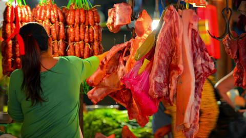 SIEM REAP. CAMBODIA - CIRCA DEC 2013: Local woman at work in public market selli Footage