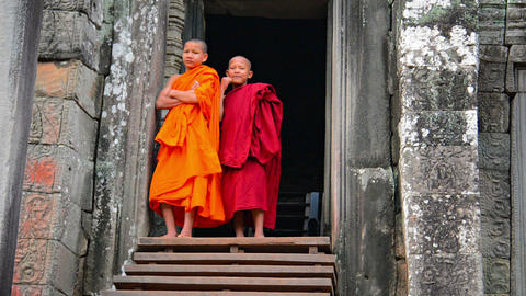 SIEM REAP. CAMBODIA - CIRCA DEC 2013: Two child monks in traditional robes are c Footage