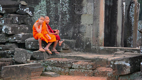 SIEM REAP. CAMBODIA - CIRCA DEC 2013: Two young monks in traditional robes sitti Footage