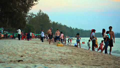 SIHANOUKVILLE. CAMBODIA - CIRCA DEC 2013: Tourists swim. wade and play along the Footage