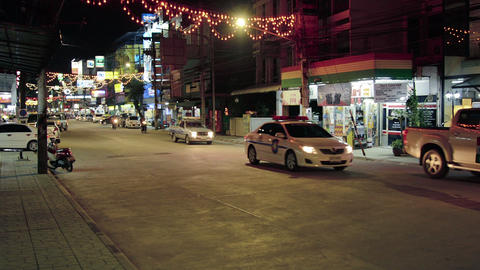 CHIANG RAI. THAILAND - CIRCA DEC 2013: Nighttime Traffic and Lighted Signs on an Footage