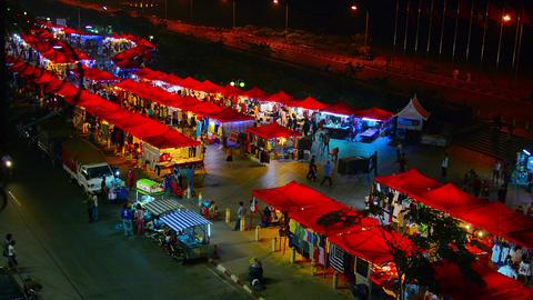 VIENTIANE. LAOS - CIRCA DEC 2013: Illuminated tents of a nighttime public market Footage