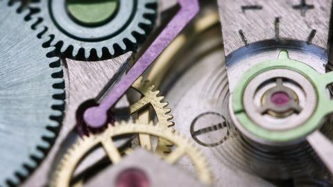 Closeup of Clockwork Mechanism inside a Watch Footage