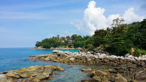 UHD video - Beautiful. rocky beach in Phuket. Thailand. under a partly cloudy sk Footage