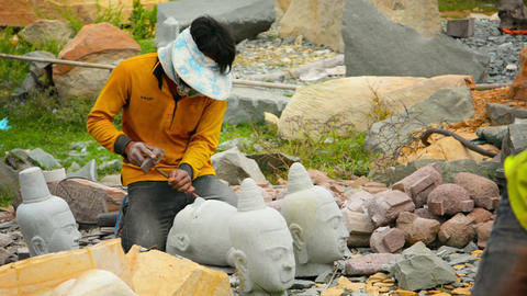 KHAMPONG THOM. CAMBODIA - CIRCA DEC 2013: Local artisan chiseling and carving on Live Action