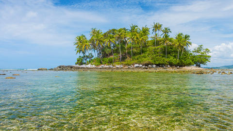 Small Tropical Island at Low Tide under Cloudy Skies Footage